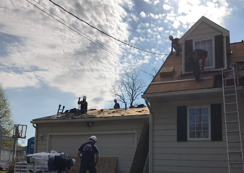 Merryfield Construction Group Outreach Program Provides New Roof for Clayton Homeowners